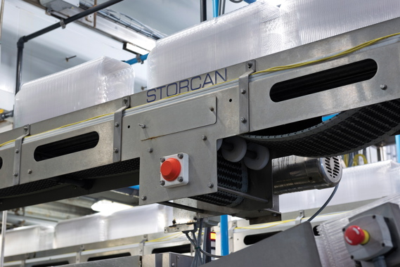 A high-performance Storcan overhead conveyor swiftly whisks stacked rows of empty plastic salad bowls onto their filling destinations and final kit assembly.