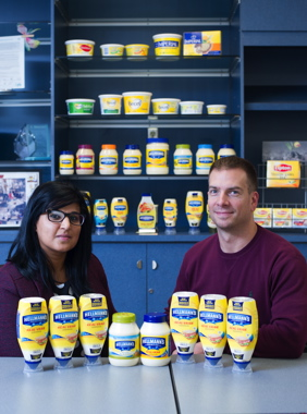 Mandeep Atwal and Galen Sienicki show off the company's innovative new upside-down, squeezable plastic bottles now being used to package the company's bestselling Hellmann's brand of mayonnaise and other popular dressing products in Rexdale.