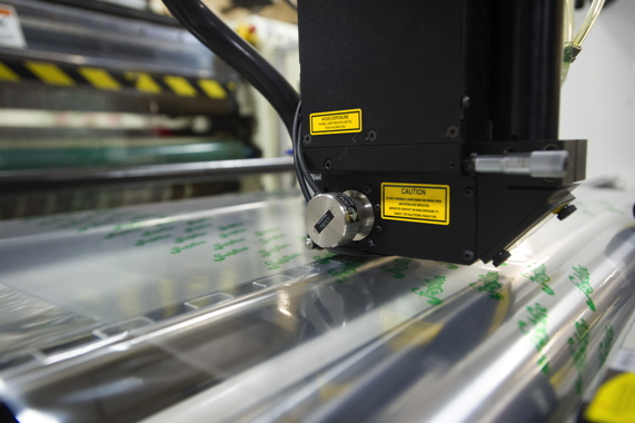 A Preco laser adding the virtually invisible laser perforations to a controlled atmosphere film to helps provided extended shelf life to packaged products thereby reducing food waste.