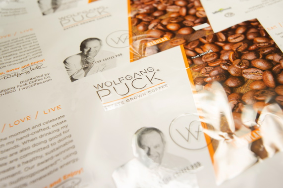 3) A close-up of some of the packaging created by Tempo Plastics showcasing the Wolfgang Puck Estate Grown Coffee brand in coffee pod format with the contents and the package being 100 percent compostable.