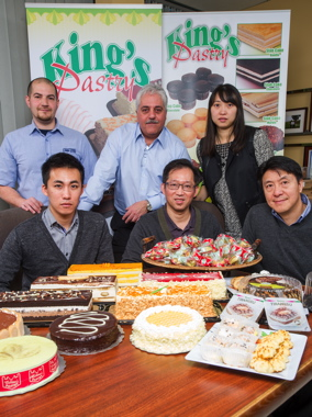 Key players in the bakery's robotics integration project include (sitting from left) King's Pastry operations manager Kelvin Tsang, co-owner Lewis Tsang and director of marketing Kevin Chan, joined by (standing from left) ABI communications director Aaron Burke and sales rep Tony Cacciola, and King's Pastry engineering coordinating manager Ivy Jiang.