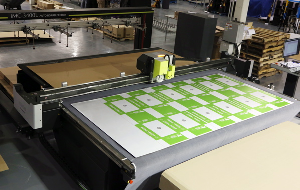 Strategically positioned about 20 feet across from the nearby HP Scitex 15500 corrugated press, the fully-automatic Kongsberg digital flat-bed cutting table is used by the Retail Packaging & Display Division facility to die-cut the digitally-printed sheets.
