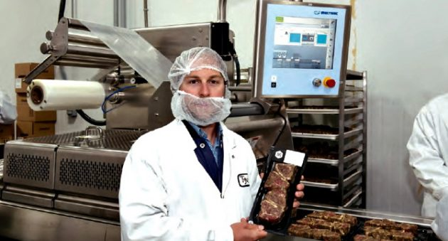 Maillard president Pascal Arsenault holds up a finished package of seasoned high-grade lamb chops just coming off the Multivac R175 CD vacuum-sealing machine installed at the company's Terrebonne processing facility that already turns out more than 200 different stock-keeping units of high-quality meat products ranging from beef and pork to poultry and game meats.
