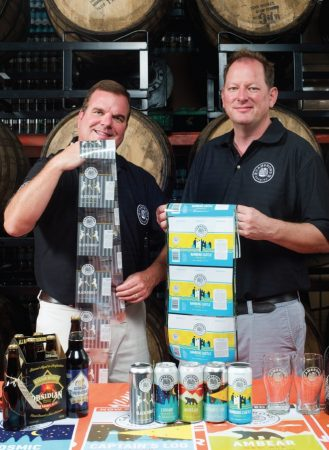 Cameron's Brewing Company president Bill Coleman (left) and brewmaster Jason Britton showing off some of the newly-designed packaging for its core and seasonal brands.