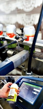 The Domino model A201i continuous inkjet printer is used to apply production date codes onto the bottom part of the filled aluminum beer-cans.