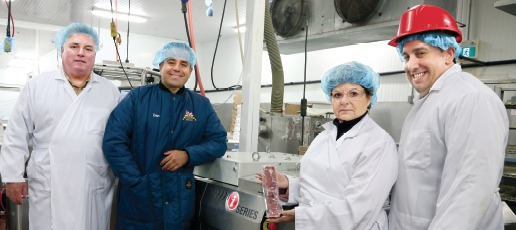 From Left: The Elite Meat Company director of sales Peter Daly; president Dan Milanovic; VC999 Canada Ltd. Ontario regional sales manager Danielle Ladouceur holding a pack of pork tenderloin sealed on the VC999 iSeries thermoform machine; and Elite's plant manager John Longo.